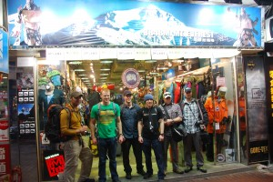 One of Our Wounded Warriors (L) Stands Next to the Summit Team at Outdoor Store in Hong Kong
